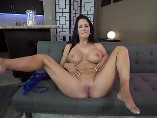Reagan Foxx uses a dildo to reach strong shinny up on the couch